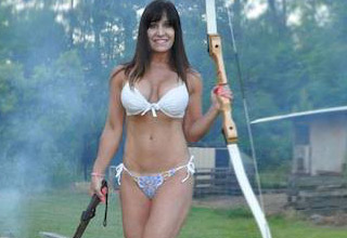 49-year-old Farm Girl Jen makes a living on Youtube videos where she shoots guns, cuts down trees, and drives tractors all while wearing nothing but a bikini.