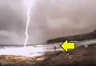 girl on the beach almost struck by lightning