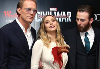 he was caught taking a peek at Elizabeth Olsen's breasts at the Captain America premiere