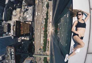 Angela Nikolau has been pushing the selfie to new heights.
