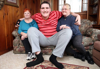 19-year-old Broc Brown, grows 6 inches every year. The Michigan young man has already reached 7 feet 8 inches tall. At this rate, he could surpass the current world's tallest man, who stands at 8 feet 2 inches.