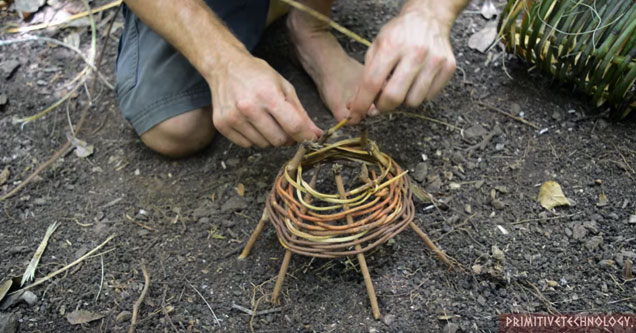 a guy building a shrimp trap