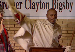 Dave Chappelle as Clayton Bigsby, the black, blind KKK member