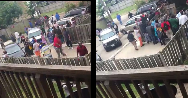 a large group of people standing by alleged dope house | chicago dope house reopens with many visitors