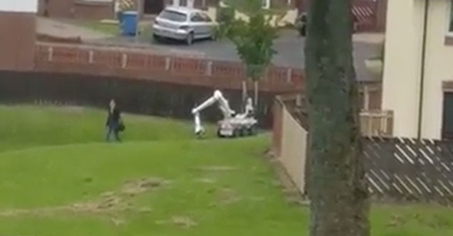 Oblivious Woman Walks By Controlled Demolition Robot