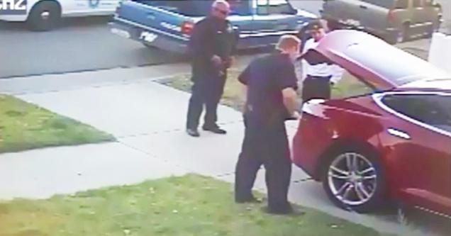 cops looking at trunk of tesla model s