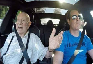 This guy can't believe how cool and powerful his son's new Tesla is.
