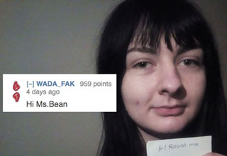woman with bangs holding a roast me sign and a roast that says Hi Ms. Bean