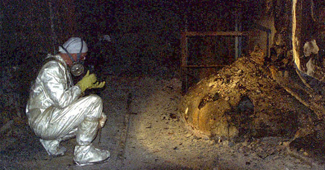 photographer capturing images of the melted core at Chernobyl