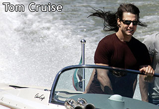 Tom Cruise driving a boat