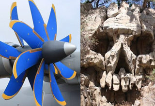 a blue and gold airplane propeller and a skull carved into a rock face