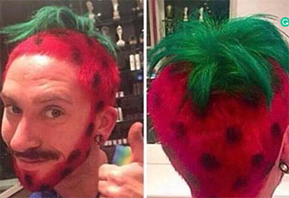 a man with his hair cut and dyed green and red like a strawberry