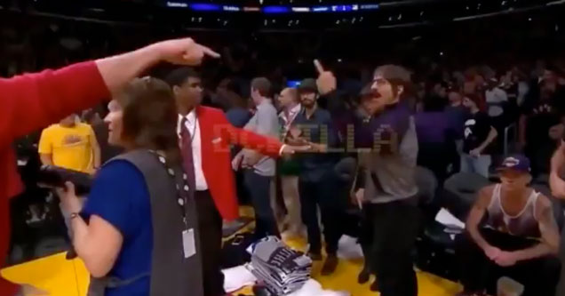 Red Hot Chili Peppers lead singer Anthony Kiedis giving the finger to a Rockets Coach
