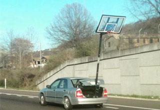 a guy hauling a basketball hoop.