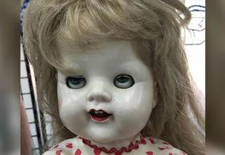 Creepy AF doll.