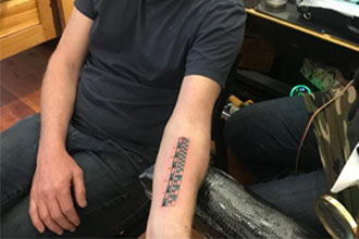 A guy with a ruler tattoo.