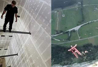 Man standing on bar high up. Man skydiving.