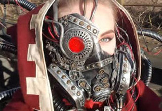 a blonde haired women in a steampunk cyborg cosplay