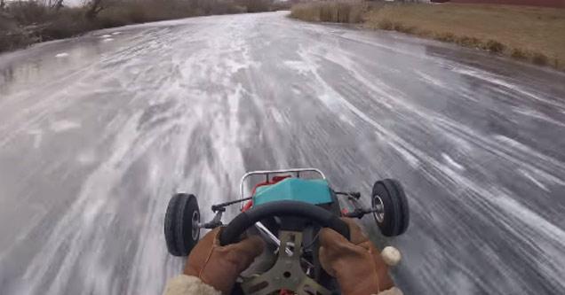 a man driving a go kart on a frozen lake