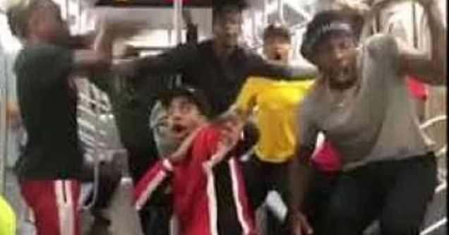 Boys on the subway going crazy.