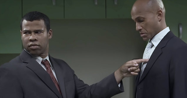 a still from key and peele sketch called flicker where joran peele is pointing at keegan michael key