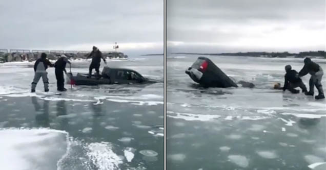 Rescuers help pull a man out of his truck after he crashed it into the ice in Lexington Harbor.