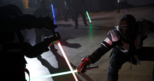 Two french lightsaber fencers.