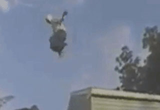 Man jumping from roof.