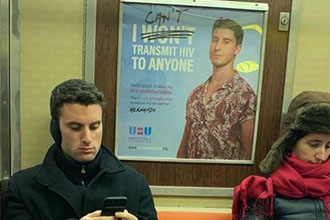A guy with a picture of another guy who looks like him.