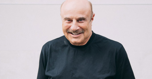 a photo of dr phil smiling wearing a black shirt