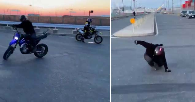 a motorcycle driving by and a dude jumps off and lands smoothly