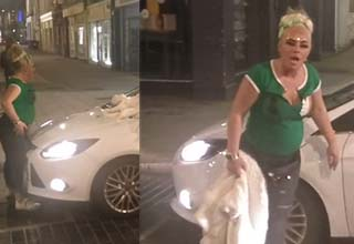 a woman in green leaving a car and looking angry