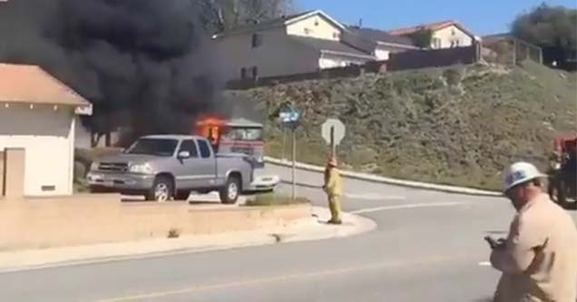 a truck on fire heading down a residential street
