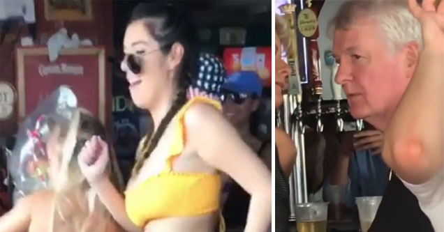 a lady dancing with a yellow tank top and a man looking at her at a bar