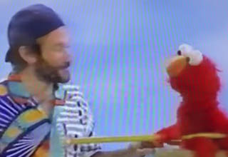 Robin Williams and Elmo on Sesame Street.