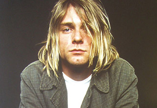 "Kurt Cobain died 25-years-ago today at the age of 27 as the result of suicide.  He left behind an incredible legacy that has lived on many years after his death and will continue on for many more. <br> <br> Also check out <a href=""https://www.ebaumsworld.com/pictures/kurt-cobains-crime-scene-photos/84832307/"" target=new>Kurt Cobain's crime scene photos</a>"