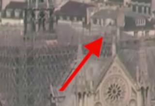 a photo of the city of notre dame and a red arrow pointing to a man on a roof top