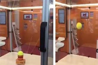 A tennis ball in a machine.