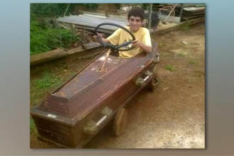 A boy driving a coffin