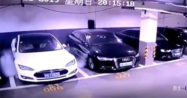 a tesla smoking in a chinese parking garage