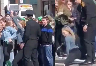 St. Patrick's Day Parade Girl grinding twerking on cop.