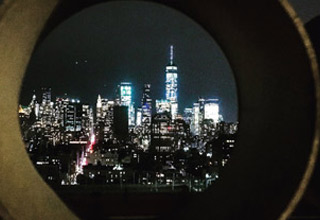 a photo of a city through a cement tube