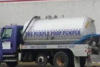 A truck with a poopy slogan.