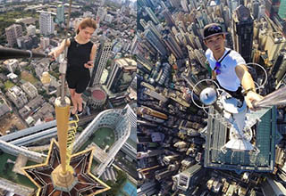 There's nothing sweeter than the taste of victory for a city climber who's reached the top of a city's highest building.  Daring, even crazy describes these climbers who commemorate their conquest with a selfie, showing off the glorious view below.