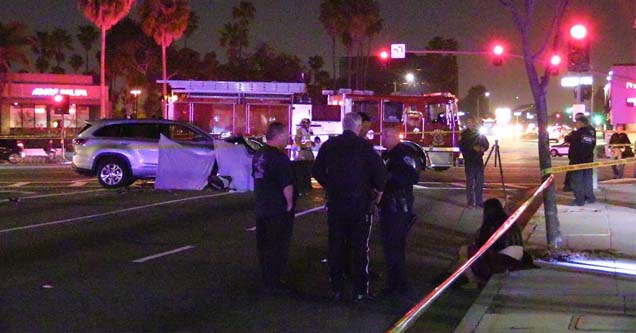 police officers in the road at the scene of a dui accident