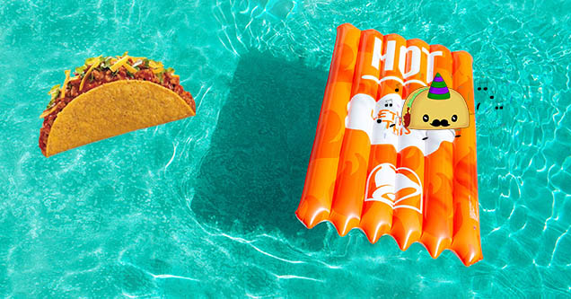 A taco riding a fire sauce pool floatie at the new Taco Bell hotel and resort