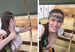emily bloom learns how to shoot an arrow