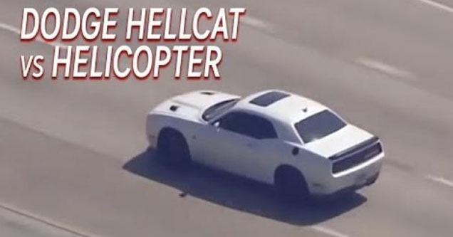 white dodge hellcat driving down the freeway