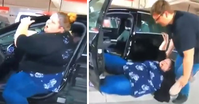 big woman works to get herself into the car