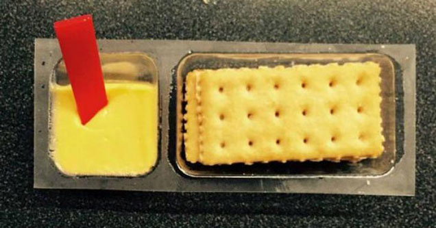 a photo of the cheese and cracker snack packs with the red stick